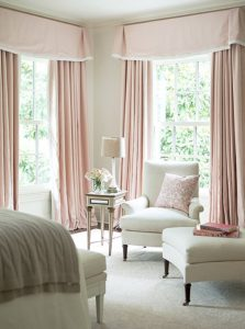 pink-valance-curtains-bedroom-sitting-area-white-roll-arm-chair-caster-legs